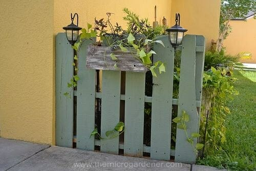 Painted Feature Fence made from a pallet via Camelot Art Creations